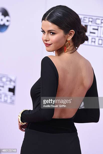 Actress/singer Selena Gomez arrives at the 2014 American Music Awards at Nokia Theatre LA Live on November 23 2014 in Los Angeles California