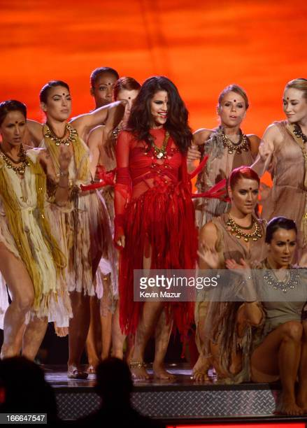 Actress/singer Selena Gomez performs onstage during the 2013 MTV Movie Awards at Sony Pictures Studios on April 14 2013 in Culver City California