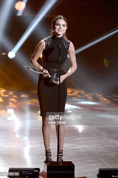 Actress/singer Selena Gomez receives the Fan Favorite Album Award and Most Anticipated Tour Award at the CW Network's 2013 Young Hollywood Awards...