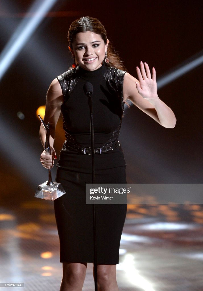 Actress/singer Selena Gomez receives the Fan Favorite Album Award and Most Anticipated Tour Award at the CW Network's 2013 Young Hollywood Awards presented by Crest 3D White and SodaStream held at The Broad Stage on August 1, 2013 in Santa Monica, California.