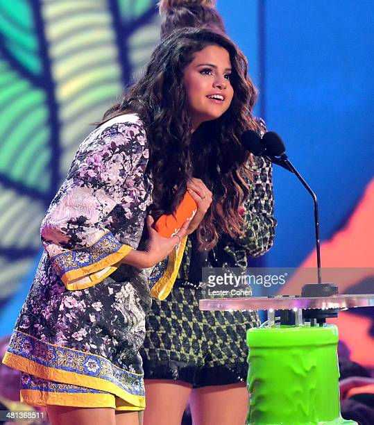 Actress/singer Selena Gomez speaks onstage during Nickelodeon's 27th Annual Kids' Choice Awards held at USC Galen Center on March 29 2014 in Los...