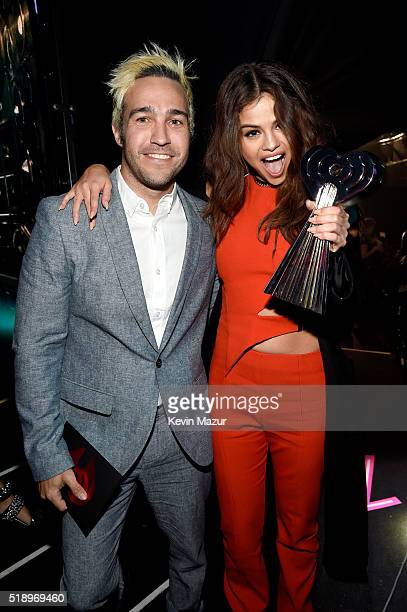 Actress/singer Selena Gomez winner of the Triple Threat award and musician Pete Wentz pose backstage at the iHeartRadio Music Awards which...