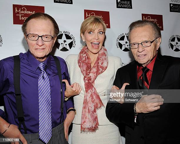 Actress/singer Shawn Southwick King poses with television host Larry King and a Madame Tussauds waxwork figure of Larry King during the Hollywood...