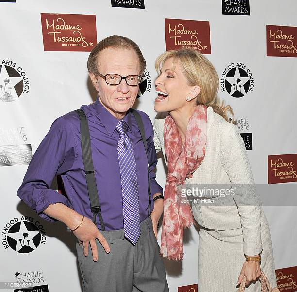 Actress/singer Shawn Southwick King poses with the life like copy of her husband Larry King from Madame Tussauds at the Hollywood Arts Council's 25th...