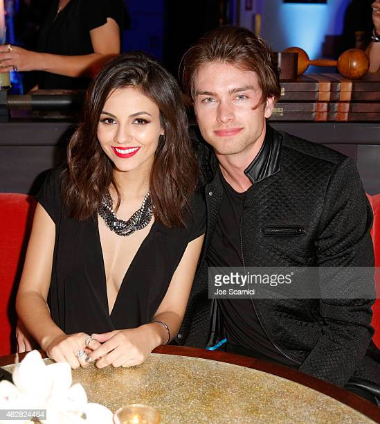 Actress/singer Victoria Justice and Pierson Fode attends a celebration of the 57th annual GRAMMY Awards hosted by Delta Air Lines the official...