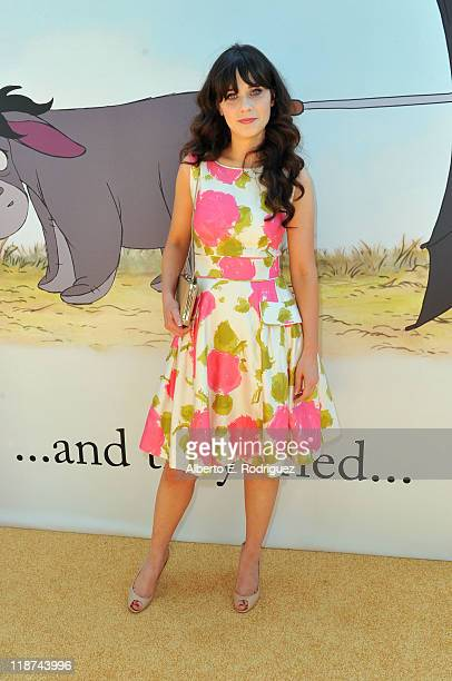 Actress/singer Zooey Deschanel arrives at Walt Disney Pictures presents the premiere of Winnie The Pooh at Walt Disney Studios on July 10 2011 in...