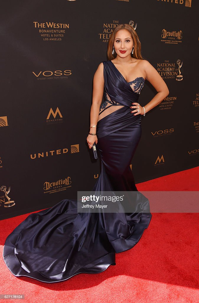 Actress/singer-songwriter Adrienne Bailon attends the 2016 Daytime Emmy Awards - Arrivals at Westin Bonaventure Hotel on May 1, 2016 in Los Angeles, California.