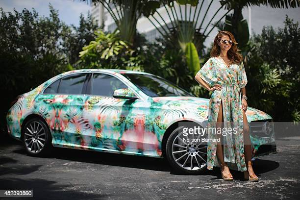Actress/television host Maria Menounos poses for a picture with a 2015 MercedesBenz CClass featuring an exclusive design by Luli Fama at MercedesBenz...