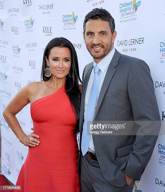Actress/TV personality Kyle Richards and husband Mauricio Umansky arrive at a fashion fundraiser hosted by Kyle Richards benefiting Children's...