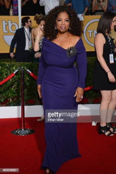 ActressTV personality Oprah Winfrey attends the 20th Annual Screen Actors Guild Awards at The Shrine Auditorium on January 18 2014 in Los Angeles...