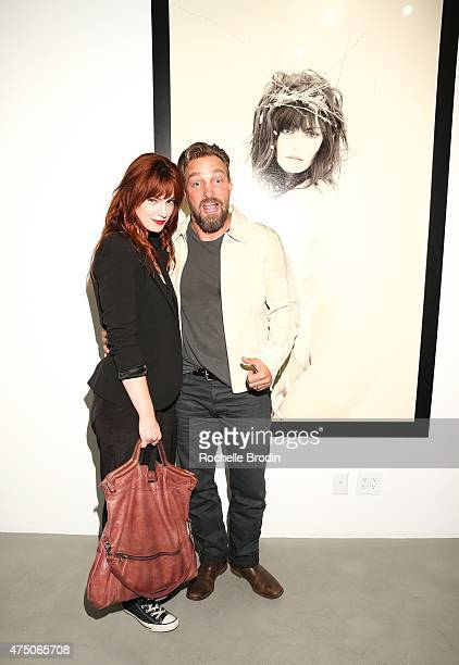 Actress/writer Diana Gettinger and photographer/artist Brian Bowen Smith attend the 'Blue Nudes' exhibtion at De Re Gallery on May 28 2015 in West...