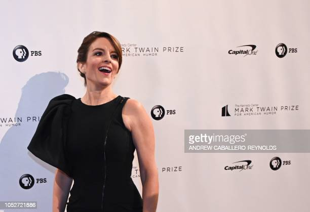 Actress/writer Tina Fey reacts on the red carpet for the 21st Annual Mark Twain Prize for American Humor at the Kennedy Center in Washington DC on...