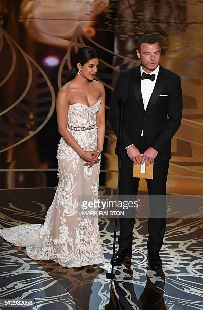 Actror Liev Schreiber and actress Priyanka Chopra present the award for best Achievement in Film Editing on stage at the 88th Oscars on February 28...