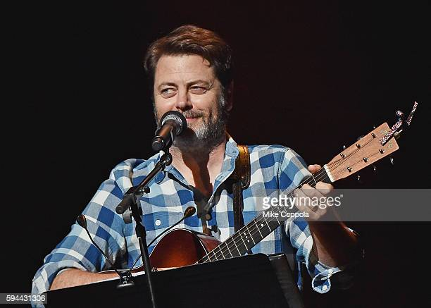 Actror Nick Offerman performs Summer Of 69 No Apostrophe with wife Megan Mullally at Beacon Theatre on August 23 2016 in New York City