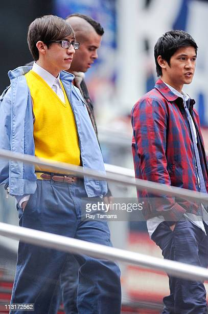 """Actrors Kevin McHale, Mark Salling, and Harry Shum Jr. Film on the set of """"Glee"""" in Times Square on April 25, 2011 in New York City."""