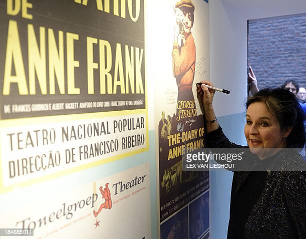 US actrress Millie Perkins signs a posterat the opening of 'This play is a part of my life' an exhibition of the diary of Anne Frank in movies and...