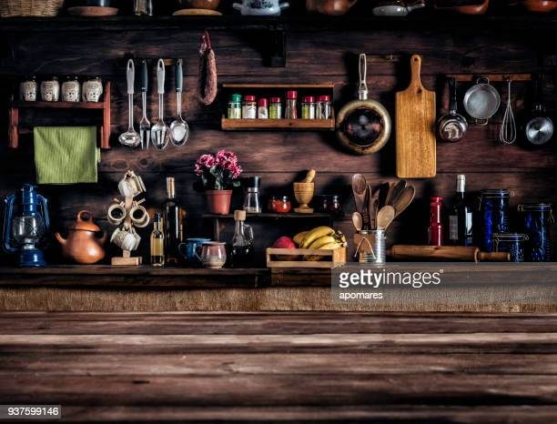 actual rustic kitchen with utensils for cooking. table at the foreground with copy space - kitchen stock pictures, royalty-free photos & images