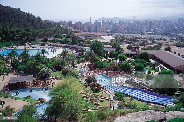 Acuatic Park of Benidorm Alicante The park full with visitors To the bottom the city of Benidorm the biggest tourist center in the Mediterranean