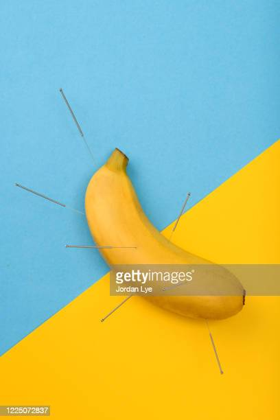 acupuncture a banana - erectile dysfunction stock pictures, royalty-free photos & images