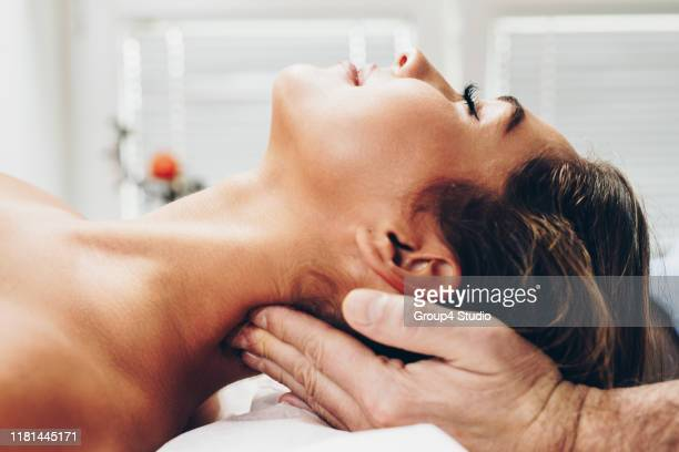 acupuncture and massage treatment - acupuncture stock pictures, royalty-free photos & images