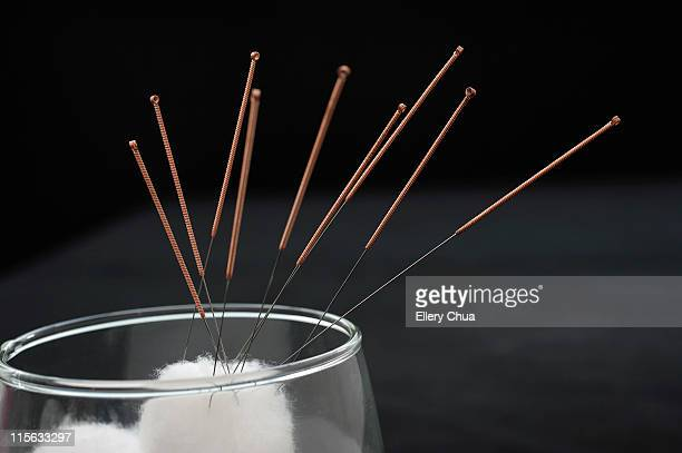 acupuncture needles in cotton - acupuncture needle stock pictures, royalty-free photos & images