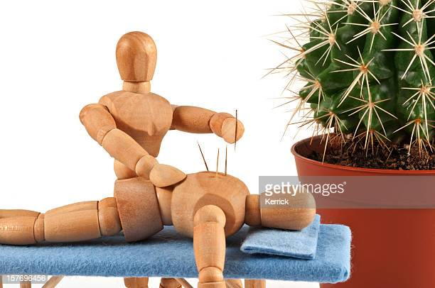 acupuncture - wooden mannequin with special needles - acupuncture needle stock pictures, royalty-free photos & images