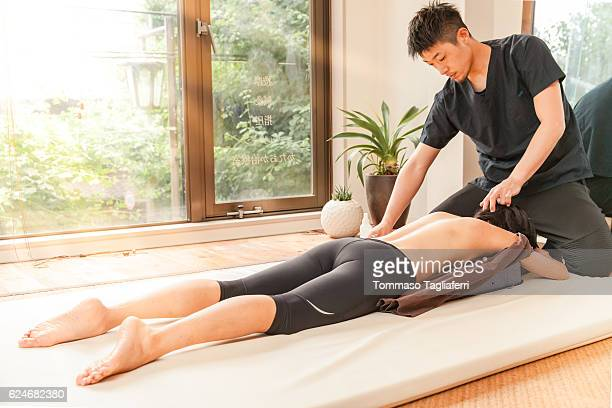 acupuncturist at work in kyoto - body massage japan stock pictures, royalty-free photos & images