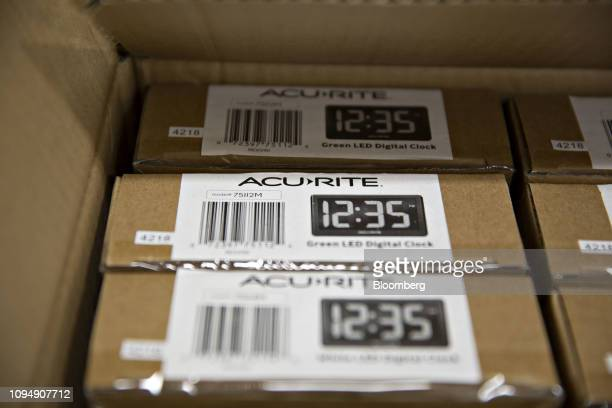 Acurite LED clocks sit in a box in the directtoconsumer packaging area at the Primex Family of Cos facility in Lake Geneva Wisconsin US on Tuesday...