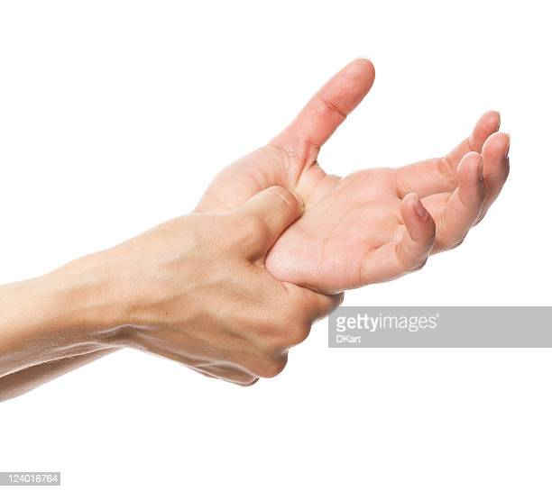 acute pain in a women hand - thumb stock pictures, royalty-free photos & images