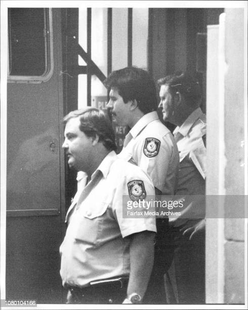 Ad Arrest Police surround a police van taking William Sutton a recaptured escapee from Central cells to Newtown court April 05 1984
