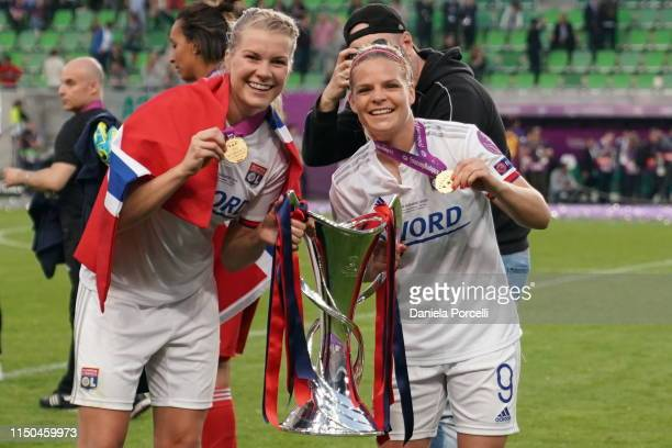 Ada Hegerberg and Eugénie Le Sommer of Olympique Lyonnais with the trophy after the UEFA Women's Champions League Final between Olympique Lyonnais...