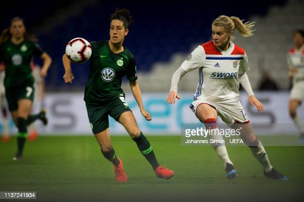 Ada Hegerberg of Lyon and Claudia Neto of Wolfsburg fight for the ball during the UEFA Women's Champions League Quarter Final First Leg match between...