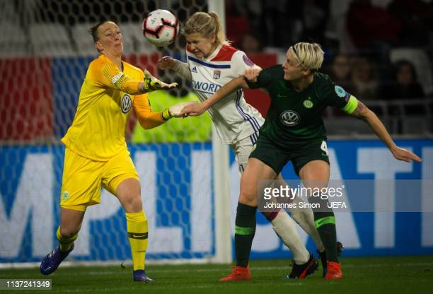 Ada Hegerberg of Lyon and goalkeepee Almuth Schult and Nilla Fischer of Wolfsburg fight for the ball during the UEFA Women's Champions League Quarter...