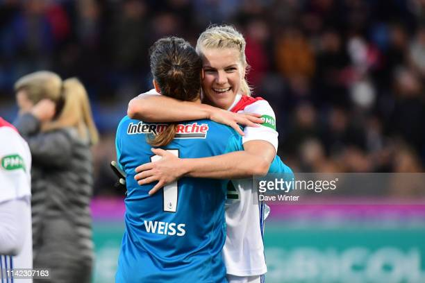 Ada Hegerberg of Lyon and Lisa Weiss of Lyon celebrate winning the French Women's Final Cup match between Lyon and Lille on May 8 2019 in Chateauroux...