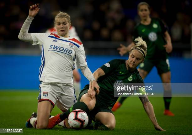 Ada Hegerberg of Lyon and Nilla Fischer of Wolfsburg fight for the ball during the UEFA Women's Champions League Quarter Final First Leg match...