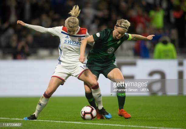 Ada Hegerberg of Lyon and Nilla Fischer of Wolfsburg fightfor the ball during the UEFA Women's Champions League Quarter Final First Leg match between...