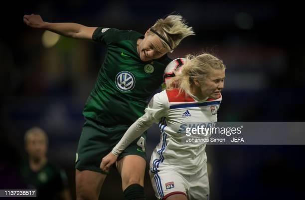 Ada Hegerberg of Lyon and Nilla Fischer of Wolfsburg head for the ball during the UEFA Women's Champions League Quarter Final First Leg match between...