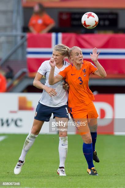 Ada Hegerberg of Norway and Stephanie van der Gragt of the Netherlands battle for the ball during their Group A match between Netherlands and Norway...