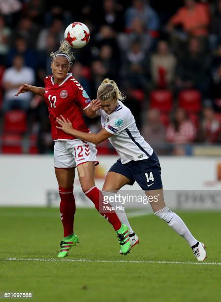 Ada Hegerberg of Norway and Stine Larsen of Denmark compete for the ball during the Group A match between Norway and Denmark during the UEFA Women's...
