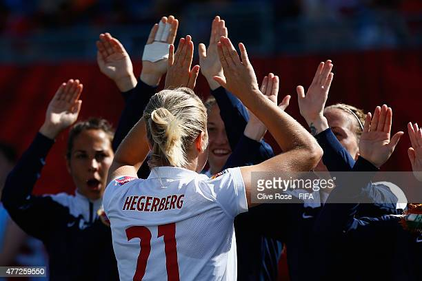 Ada Hegerberg of Norway high fives her team prior to the FIFA Women's World Cup 2015 Group B match between Cote D'Ivoire and Norway at Moncton...