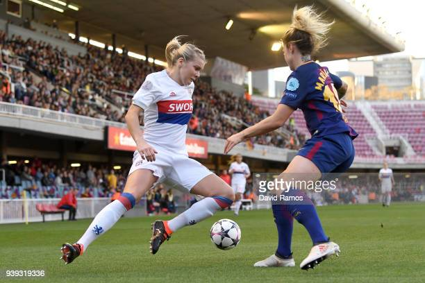 Ada Hegerberg of Olympique Lyon is challenged by María León of FC Barcelona during the UEFA Women's Champions League Quarter Final 2nd Leg between FC...