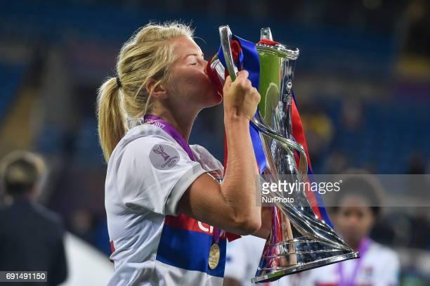 Ada Hegerberg of Olympique Lyon kisses the Champions League Trophy during the UEFA Women's Champions League Final between Lyon Women and Paris Saint...