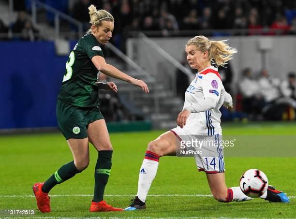 Ada Hegerberg of Olympique Lyonnais against Lena Goessling of Vfl Wolfsburg during the UEFA Women's Champions League Quarter final football match...