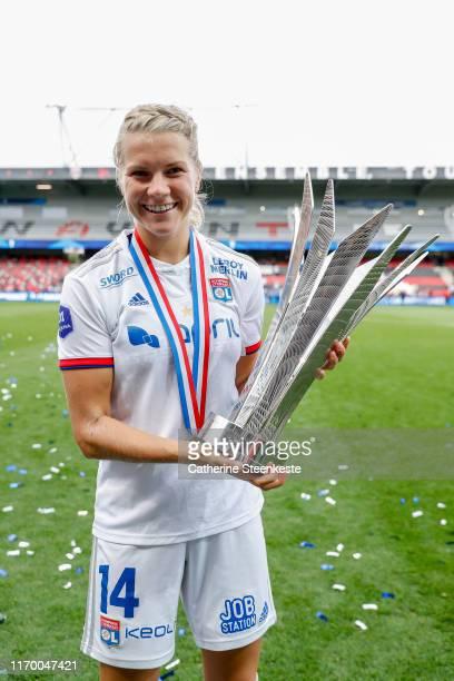 Ada Hegerberg of Olympique Lyonnais celebrates the victory of the Trophee des Championnes between Olympique Lyonnais and Paris SaintGermain at Stade...