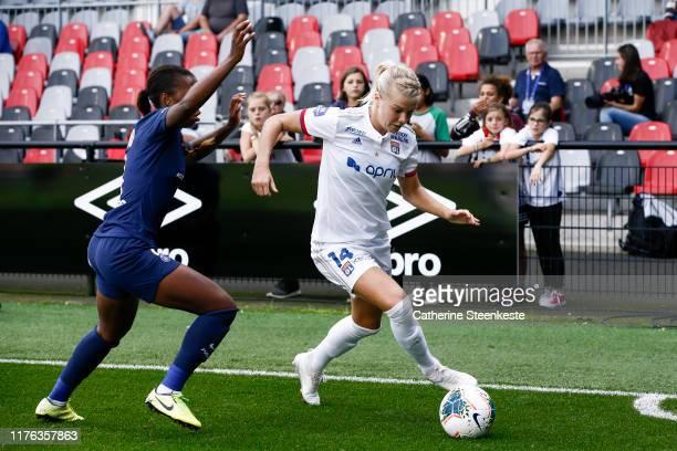 Ada Hegerberg of Olympique Lyonnais controls the ball against Grace Geyoro of Paris SaintGermain during the Trophee des Championnes match between...