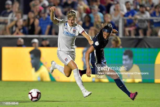 Ada Hegerberg of Olympique Lyonnais is defended by Abby Erceg of North Carolina Courage during the International Champions Cup championship match at...