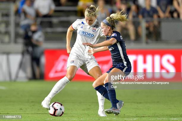 Ada Hegerberg of Olympique Lyonnais is defended by Denise O'Sullivan of North Carolina Courage during the International Champions Cup championship...