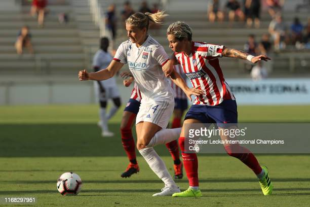Ada Hegerberg of Olympique Lyonnais is defended by Elena Linari of Atletico de Madrid during the International Champions Cup match at WakeMed Soccer...