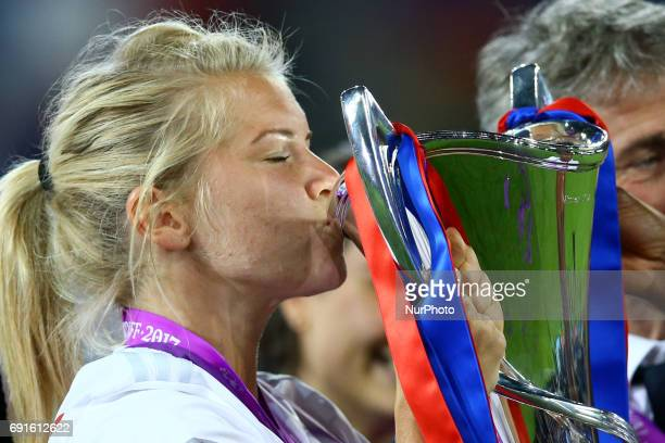Ada Hegerberg of Olympique Lyonnais kiss the trophy during the award ceremony after the UEFA Women's Champions League final football match between...