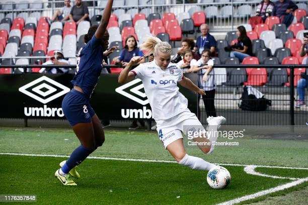 Ada Hegerberg of Olympique Lyonnais shoots the ball against Grace Geyoro of Paris SaintGermain during the Trophee des Championnes match between...